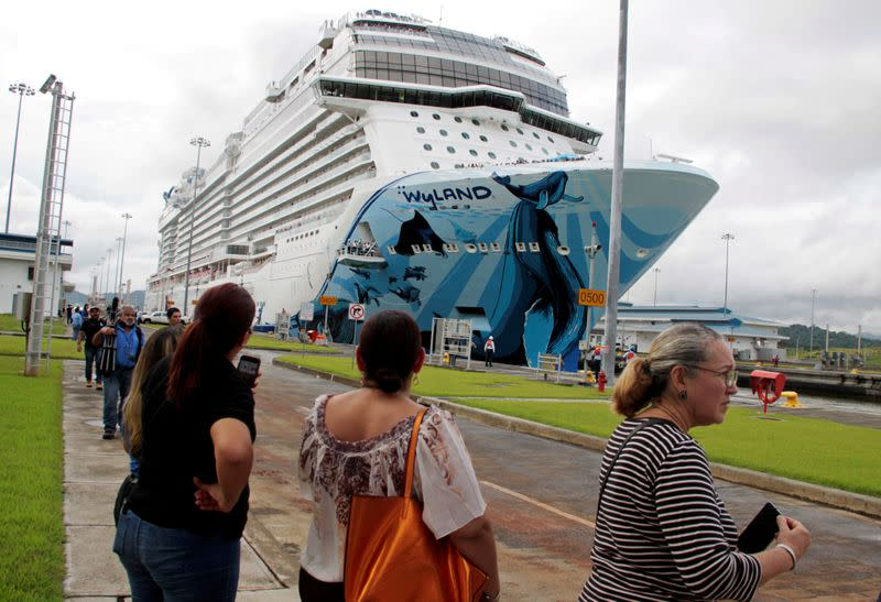 FILE PHOTO: People look at Norwegian Bliss, the largest cruise ship to transit the expanded Panama Canal through Cocoli locks, as it passes through the Canal on the outskirts of Panama City