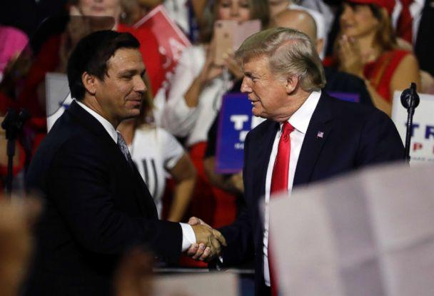 PHOTO: Florida Republican gubernatorial candidate Ron DeSantis shakes hands with President Donald Trump, July 31, 2018, during a rally in Tampa, Fla. (Chris O'Meara/AP)