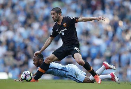 Britain Football Soccer - Manchester City v Hull City - Premier League - Etihad Stadium - 8/4/17 Hull City's Evandro Goebel in action with Manchester City's Raheem Sterling Reuters / Andrew Yates Livepic
