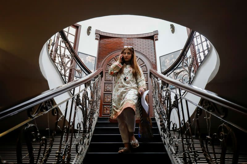 Dananeer Mobeen, a social media influencer who has become famous after her five-second video went viral, descends a staircase in Karachi, Pakistan