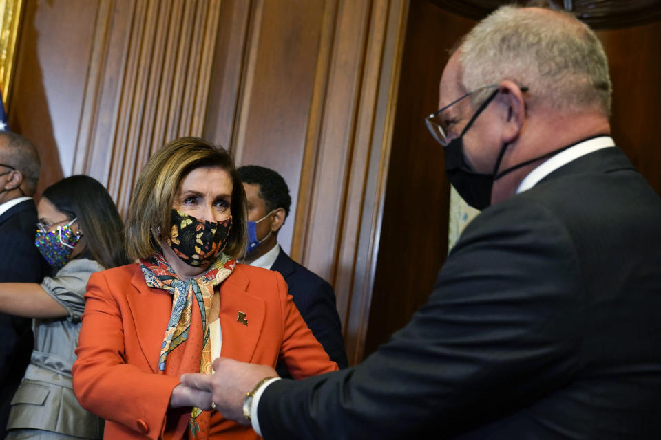 House Speaker Nancy Pelosi of Calif., talks with Louisiana Gov. John Bel Edwards during a ceremonial swearing-in photo opportunity with Rep. Troy Carter, D-La., on Capitol Hill in Washington, Tuesday, May 11, 2021. (AP Photo/Susan Walsh)