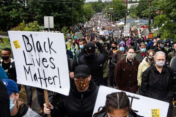 PHOTO: Protesters silently march up 23rd Avenue South in Seattle, Washington on June 12, 2020. (Noah Riffe/Anadolu Agency via Getty Images)