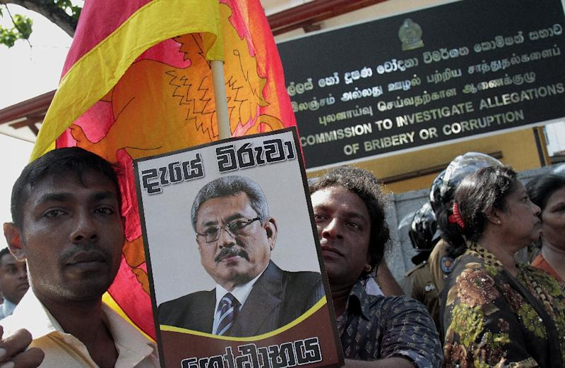 Supporters of former president Mahinda Rajapakse take part in a protest outside the Commission to Investigate Allegations of Bribery or Corruption department Colombo on April 23, 2015 (AFP Photo/Ishara S. Kodikara)