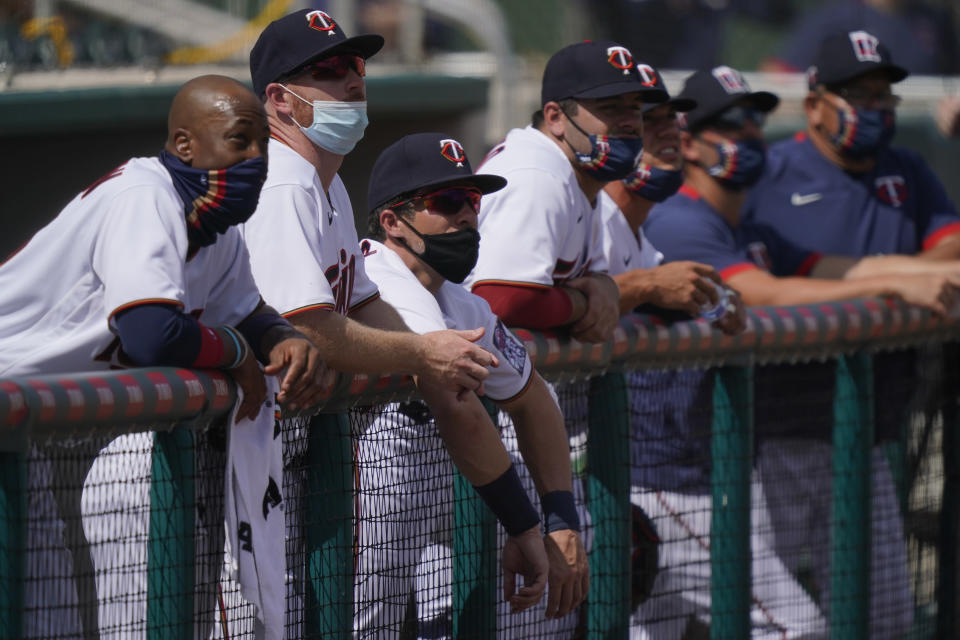The Minnesota Twins team watches from the dugout during a spring training baseball game against the Boston Red Sox on Sunday, Feb. 28, 2021, in Fort Myers, Fla. (AP Photo/Brynn Anderson)