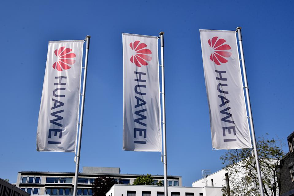 26 April 2020, North Rhine-Westphalia, Bonn: Flags with the logo, lettering of the Chinese telecommunications company HUAWEI blowing in the wind Photo: Horst Galuschka/dpa/Horst Galuschka dpa (Photo by Horst Galuschka/picture alliance via Getty Images)