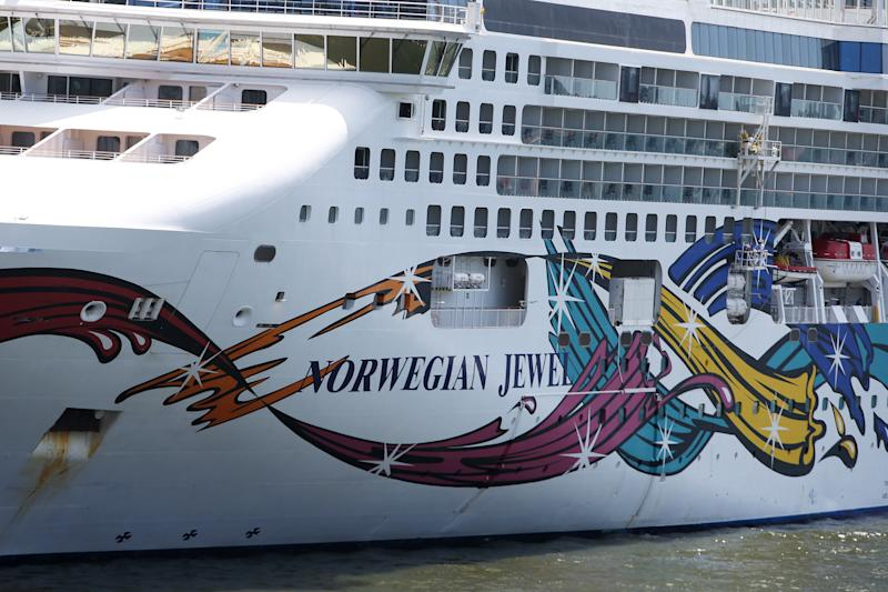 SYDNEY, AUSTRALIA - FEBRUARY 14: The Norwegian Jewel cruise ship is in lock down while health authorities test a man for Coronavirus on February 14, 2020 in Sydney, Australia. The ship is docked in Sydney this morning following a 10 day tour of New Zealand. It is unclear where the passenger who has fallen ill boarded the vessel, but he is being tested as a precaution. Authorities around the world are imposing travel bans and extra health screening measures to try and contain the spread of the coronavirus. The death toll from the flu-like virus which originated in Wuhan in the Hubei province of China is now at 1,371 More than 60,420 people have now been infected around the world, mostly inside China. (Photo by Lisa Maree Williams/Getty Images)