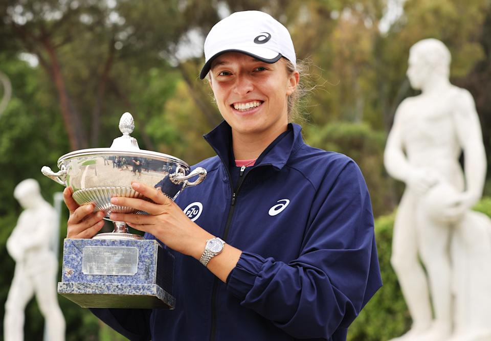 Iga Swiatek (pictured) poses with the winners trophy in Rome.