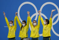 Australia's women's 4x100m women's relay team, Meg Harris, Bronte Campbell, Emma McKeon and Cate Campbell celebrate on the podium at the 2020 Summer Olympics, Sunday, July 25, 2021, in Tokyo, Japan. (AP Photo/Petr David Josek)