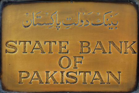 FILE PHOTO: A brass plaque of the State Bank of Pakistan is seen outside of its wall in Karachi