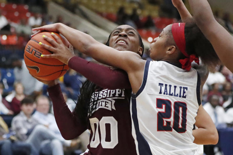 Mississippi State guard Jayla Hemingway (00) has her shot blocked by Jackson State guard J'Niya Tallie (20) during the second half of an NCAA college basketball game Thursday, Nov. 21, 2019, in Jackson, Miss. Mississippi State won 92-53. (AP Photo/Rogelio V. Solis)