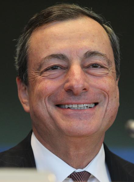 President of the European Central Bank Mario Draghi smiles as he addresses the Economic and Monetary Affairs Committee, at the European Parliament, Monday, Sept. 23, 2013. Economic affairs MEP's and Mario Draghi will debate monetary affairs, economic governance and banking union. (AP Photo/Yves Logghe)