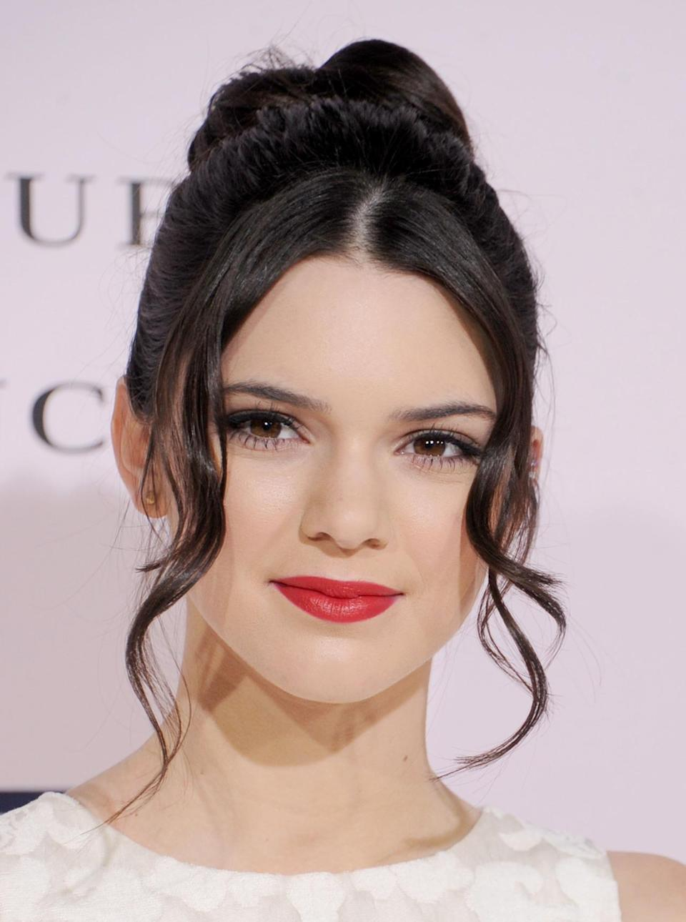 <p>At the premiere of the film, <i>The Vow</i>, in Los Angeles, Jenner dolled up in cherry red lips and an easy-breezy updo with loose tresses framing her cheeks. <i>(Photo: Getty Images)</i></p>