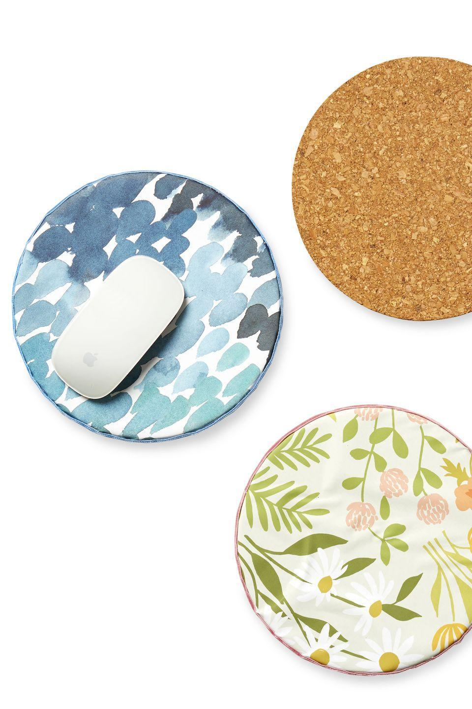 """<p>Give Mom something pretty to look at while she works with a DIY mousepad made out of cork and fabric.</p><p><strong><em>Get the tutorial at <a href=""""https://www.purelykatie.com/diy-fabric-mouse-pad/"""" rel=""""nofollow noopener"""" target=""""_blank"""" data-ylk=""""slk:Purely Katie."""" class=""""link rapid-noclick-resp"""">Purely Katie.</a></em></strong></p>"""