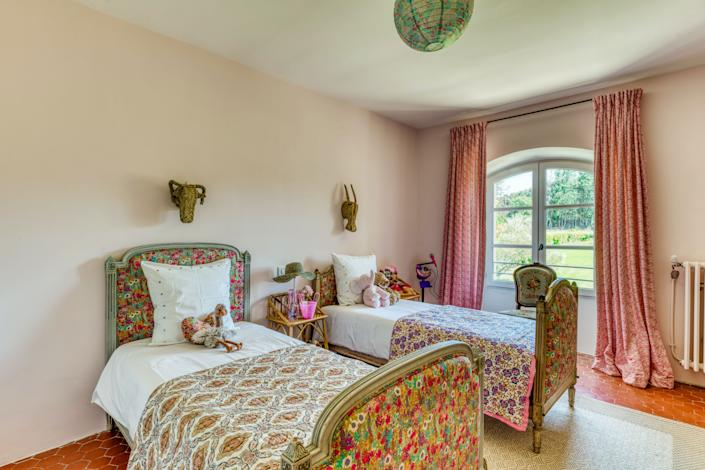 "<div class=""caption""> The bedroom of Douzal's daughter, Athina. The beds are from the Paris Flea Market at Saint Ouen, and all fabrics are <a href=""https://www.libertylondon.com/"" rel=""nofollow noopener"" target=""_blank"" data-ylk=""slk:Liberty"" class=""link rapid-noclick-resp"">Liberty</a>. The duvet is from Bloom. All sheets are from <a href=""https://www.visavisparis.com/"" rel=""nofollow noopener"" target=""_blank"" data-ylk=""slk:Vis-a-Vis"" class=""link rapid-noclick-resp"">Vis-a-Vis</a>. </div>"