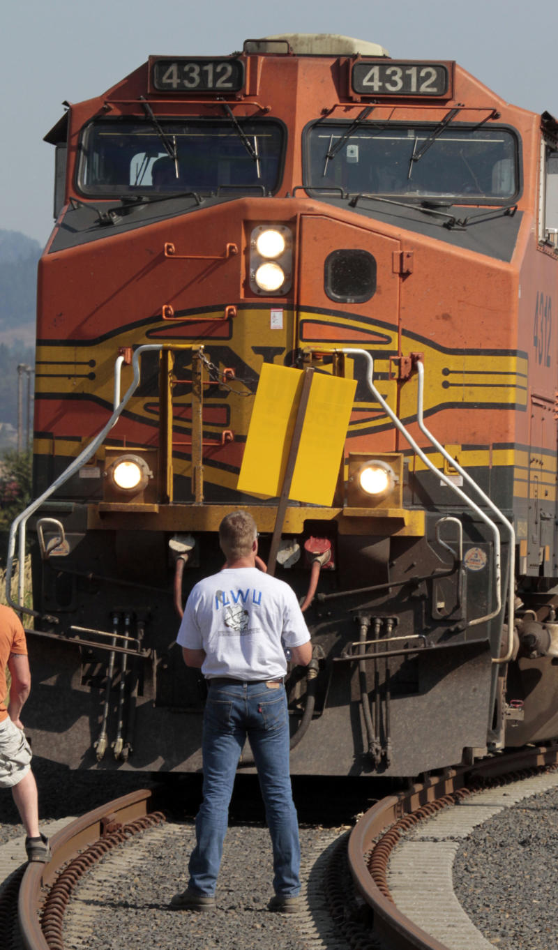 A union worker blocks a grain train in Longview, Wash.,  Wednesday, Sept. 7, 2011.   Longshoremen  blocked the train as part of an escalating dispute about labor at the EGT grain terminal at the Port of Longview.(AP Photo/Don Ryan)
