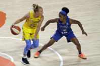 Chicago Sky guard Courtney Vandersloot (22) works against Minnesota Lynx guard Crystal Dangerfield (2) during the first half of a WNBA basketball game Thursday, July 30, 2020, in Bradenton, Fla. (AP Photo/Chris O'Meara)