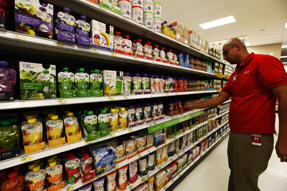 <p> A store employee stocks baby food pouches on the shelf in the baby food aisle in City Target on Thursday, Jan. 3, 2013, in downtown Los Angeles. The popularity of pouches has allowed baby food makers expand the market for their product beyond the traditional baby food years. (AP Photo/Nick Ut) </p>