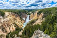 """<p>Yellowstone was established as the world's first national park in 1872, but it has been used for thousands of years as a place for tribes, bands, animals, and vegetation to flourish and call home. This magnificent park is home to world-famous sites, like Old Faithful, <a href=""""https://www.veranda.com/travel/g33337870/most-colorful-places-in-the-world/"""" rel=""""nofollow noopener"""" target=""""_blank"""" data-ylk=""""slk:Grand Prismatic Spring"""" class=""""link rapid-noclick-resp"""">Grand Prismatic Spring</a>, and the Grand Canyon of Yellowstone (shown here). </p>"""