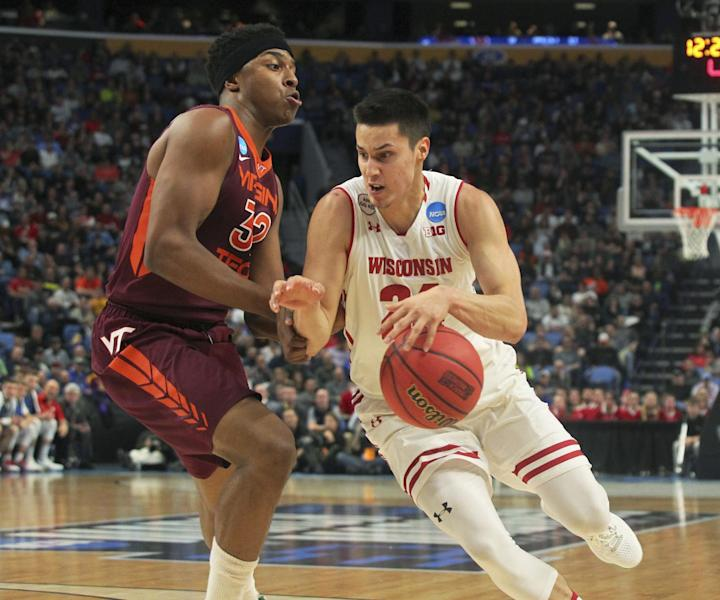 Wisconsin guard Bronson Koenig (24) drives to the basket against Virginia Tech forward Zach LeDay (32) during the first half of a first-round men's college basketball game in the NCAA Tournament, Thursday, March 16, 2017, in Buffalo, N.Y. (AP Photo/Bill Wippert)