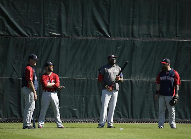 Boston Red Sox, from the left, manager John Farrell, second baseman Dustin Pedroia, designated hitter David Ortiz, and first baseman Mike Napoli stand in the outfield during spring training baseball practice Tuesday, Feb. 18, 2014, in Fort Myers, Fla. (AP Photo/Steven Senne)