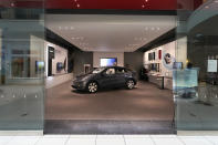 A Tesla Model Y Long Range is displayed at the Tesla Gallery on Feb. 24, 2021, in Troy, Mich. Opinion polls show that most Americans would consider an EV if it cost less, if more charging stations existed and if a wider variety of models were available. The models are coming, but they may roll out ahead of consumer tastes. And that could spell problems for the U.S. auto industry, which is sinking billions into the new technology with dozens of new vehicles on the way. (AP Photo/Carlos Osorio)