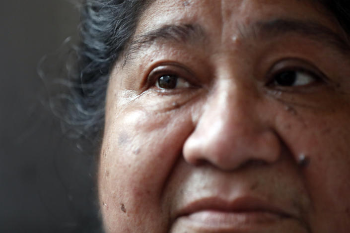 Maria Elena Estamilla, 62, sheds tear while sharing her struggle of remaining without an insurance, Wednesday, June 30, 2021, at her house in Chicago's Pilsen neighborhood. Most mornings, Estamilla wakes up with pelvic pain and dread that she faces the same fate as her mother and grandmother: fatal cervical cancer. (AP Photo/Shafkat Anowar)