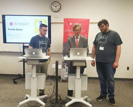 Earl Gohl co-director of the Appalachian Regional Commission in a coding demo with Interapt trainees in Paintsville
