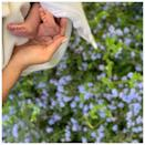 """<p>Meghan tenderly held Archie's feet in a photo with forget-me-nots – the favorite flower of <a href=""""https://people.com/tag/princess-diana"""" rel=""""nofollow noopener"""" target=""""_blank"""" data-ylk=""""slk:Princess Diana"""" class=""""link rapid-noclick-resp"""">Princess Diana</a>, Harry's late mother – on her first Mother's Day in 2019.</p> <p>""""Paying tribute to all mothers today - past, present, mothers-to-be, and those lost but forever remembered,"""" the SussexRoyal account wrote of the photo on <a href=""""https://www.instagram.com/p/BxXS3l4pz2j/?utm_source=ig_embed&ig_rid=85e9d4a5-da62-4e04-9082-2126daf7d39b"""" rel=""""nofollow noopener"""" target=""""_blank"""" data-ylk=""""slk:Instagram"""" class=""""link rapid-noclick-resp"""">Instagram</a>. """"We honor and celebrate each and every one of you.</p>"""
