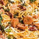 """<p>This meaty <a href=""""https://www.delish.com/uk/cooking/recipes/a28841234/three-ingredient-spaghetti-recipe/"""" rel=""""nofollow noopener"""" target=""""_blank"""" data-ylk=""""slk:spaghetti"""" class=""""link rapid-noclick-resp"""">spaghetti</a> in a cream sauce is the whole package for an easy dinner.</p><p>Get the <a href=""""https://www.delish.com/uk/cooking/recipes/a31656606/spaghetti-with-sun-dried-tomatoes-sausage-and-spinach-recipe/"""" rel=""""nofollow noopener"""" target=""""_blank"""" data-ylk=""""slk:Spaghetti with Sun-Dried Tomatoes, Sausage & Spinach"""" class=""""link rapid-noclick-resp"""">Spaghetti with Sun-Dried Tomatoes, Sausage & Spinach</a> recipe.</p>"""