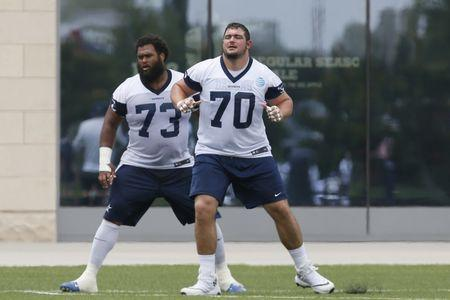 Jun 12, 2018; Frisco, TX, USA; Dallas Cowboys offensive guard Zack Martin (70) and center Joe Looney (73) participate in drills during minicamp at Dallas Cowboys headquarters at The Star. Mandatory Credit: Tim Heitman-USA TODAY Sports