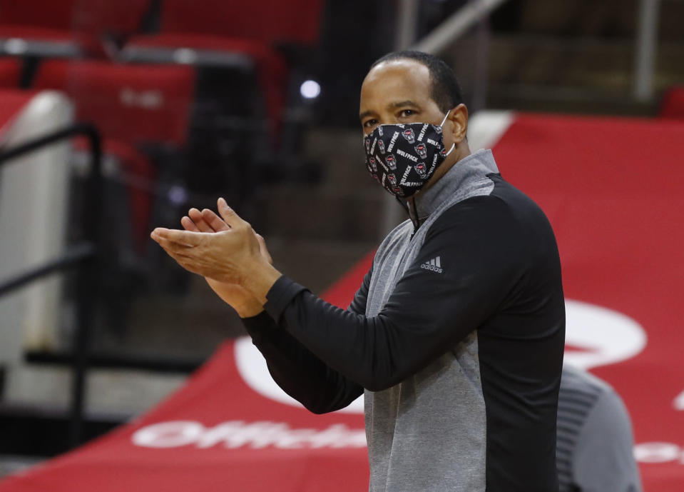 North Carolina State coach Kevin Keatts cheers on the team during the first half of an NCAA college basketball game against Wake Forest on Wednesday, Jan. 27, 2021, in Raleigh, N.C. (Ethan Hyman/The News & Observer via AP, Pool)