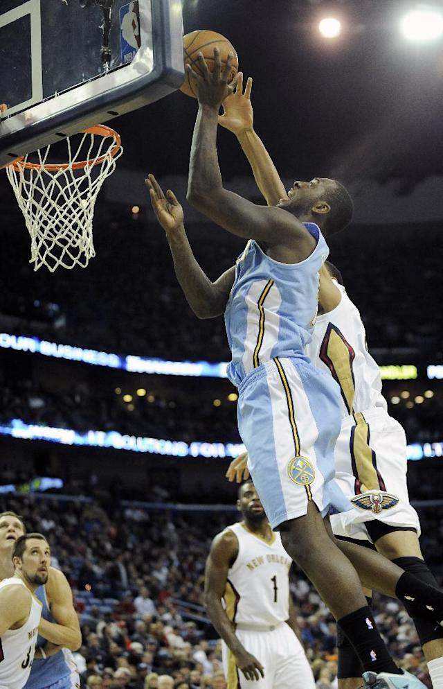 New Orleans Pelicans center Anthony Davis, right, fouls Denver Nuggets forward J.J. Hickson, left, during the first half of an NBA basketball game in New Orleans, Friday, Dec. 27, 2013. (AP Photo/Stacy Revere)