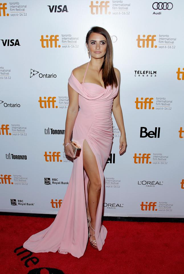 "BEST: Some say that when you wear a dress, you should either flaunt your cleavage OR your legs. But Penelope Cruz throws this rule out the window at the ""Twice Born"" premiere in this incredibly sexy pink Versace gown. Hey, rules are meant to be broken!"