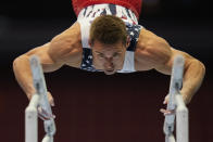 Sam Mikulak competes on the parallel bars during the men's U.S. Olympic Gymnastics Trials Thursday, June 24, 2021, in St. Louis. (AP Photo/Jeff Roberson)