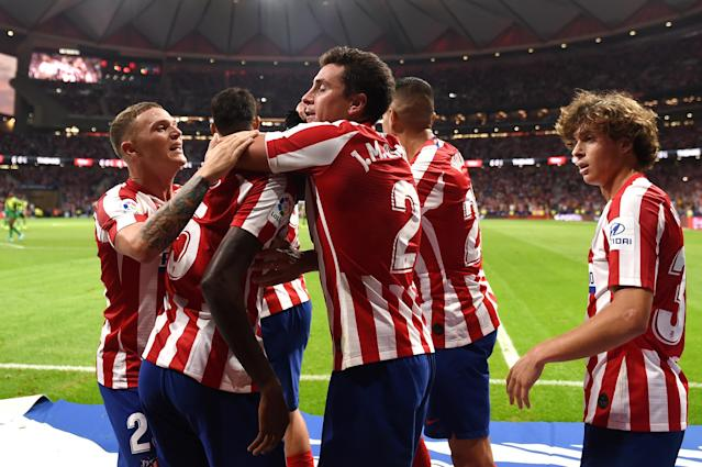Atletico Madrid celebrates after Thomas Partey (second from left) scored in stoppage time to beat Eibar. (Getty)