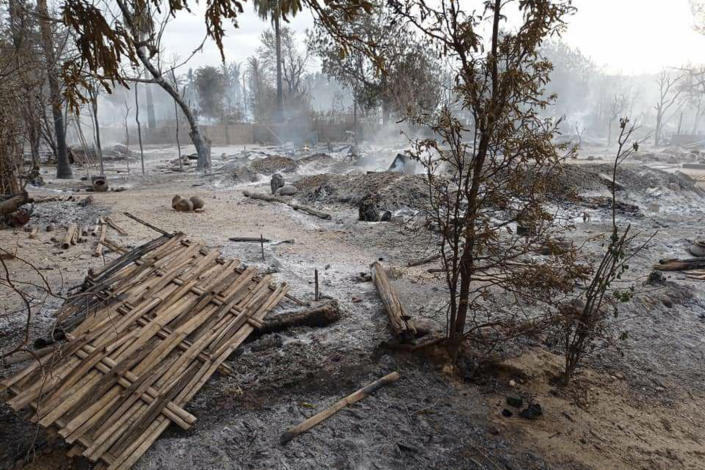 Smoke rises from smoldering houses in Kinma village, Pauk township, Magwe division, central Myanmar on Wednesday, June 16, 2021. Residents said people are missing after military troops burned the village the night before. (AP Photo)