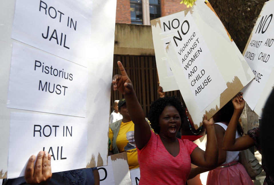Women protest outside the Pretoria Magistrates court, during the bail application hearing of South African athlete Oscar Pistorius, February 19, 2013. Pistorius, a double amputee who became one of the biggest names in world athletics, was applying for bail after being charged in court with shooting dead his girlfriend, model Reeva Steenkamp, in his Pretoria house. REUTERS/Mike Hutchings (SOUTH AFRICA - Tags: CRIME LAW SPORT ATHLETICS)