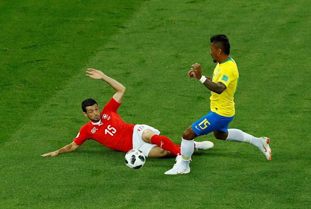 Soccer Football - World Cup - Group E - Brazil vs Switzerland - Rostov Arena, Rostov-on-Don, Russia - June 17, 2018 Brazil's Paulinho in action with Switzerland's Blerim Dzemaili REUTERS/Jason Cairnduff