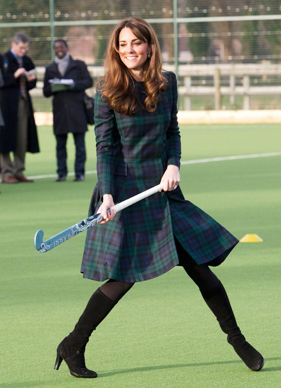 <p>There is literally nothing more British than a tartan jacket, and it's obviously versatile considering Kate wore hers (with heeled boots!) to play <em>field hockey</em> at her alma mater in 2012—perhaps not too surprising considering she wore wedges to play volleyball.</p>