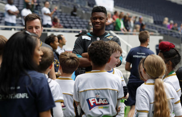 NFL player DJ Chark speaks to young players during the final tournament for the UK's NFL Flag Championship, featuring qualifying teams from around the country, at the Tottenham Hotspur Stadium in London, Wednesday, July 3, 2019. The new stadium will host its first two NFL London Games later this year when the Chicago Bears face the Oakland Raiders and the Carolina Panthers take on the Tampa Bay Buccaneers. (AP Photo/Frank Augstein)
