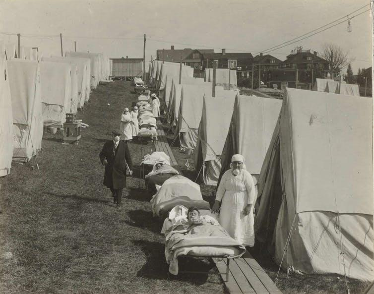 An old archival picture showing an outdoor hospital.