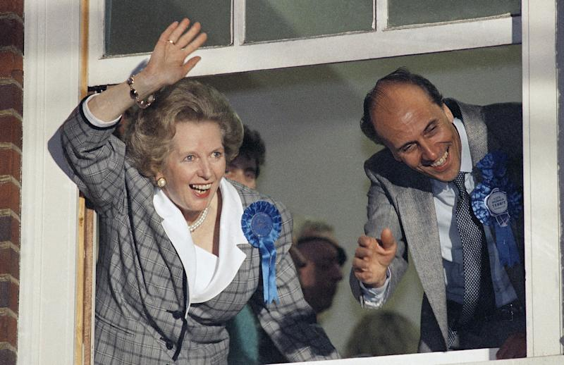 Minister Margaret Thatcher waves to supporters from Conservative Party headquarters in London after claiming victory in Britain's general election 1987