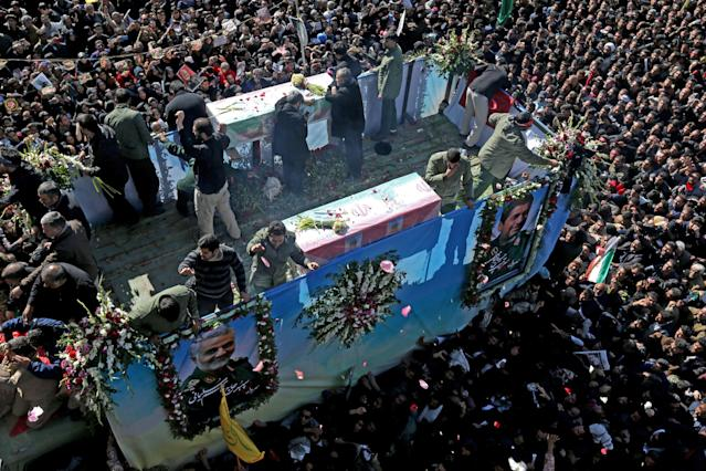 Iranian mourners gather around a vehicle carrying Qassem Soleimani's coffin in Kerman (AFP/Getty)