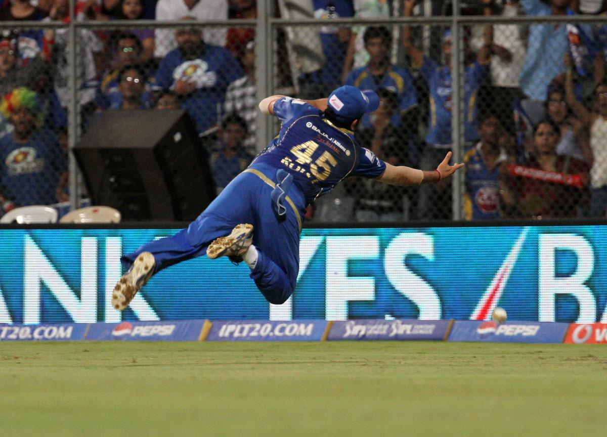 Mumbai Indian captain Rohit Sharma dives to take a catch during match 41 of the Pepsi Indian Premier League ( IPL) 2013 between The Mumbai Indians and the Kings XI Punjab held at the Wankhede Stadium in Mumbai on the 29th April 2013. (BCCI)