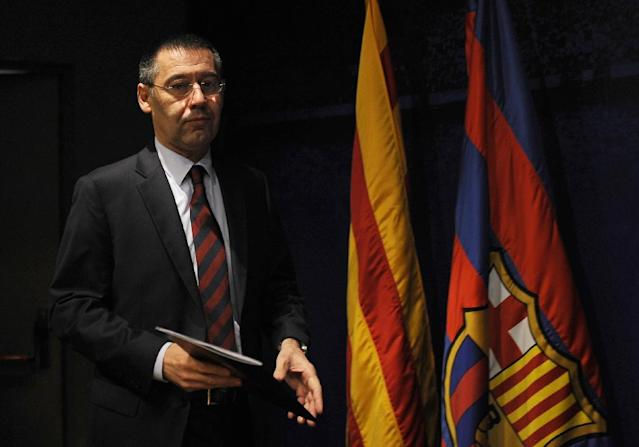 FC Barcelona's President Josep Maria Bartomeu arrives for a press conference at the Camp Nou stadium in Barcelona, Spain, Friday, Jan 24, 2014. Barcelona says its board of directors is calling an ''extraordinary'' meeting, fueling Spanish media reports that club president Sandro Rosell is under pressure to consider stepping down due to the lawsuit regarding Neymar's transfer. Barcelona said in a statement that the meeting will take place on Thursday afternoon, a day after a judge agreed to hear a lawsuit brought by a Barcelona club member over the cost of Neymar's signing. (AP Photo/Manu Fernandez)