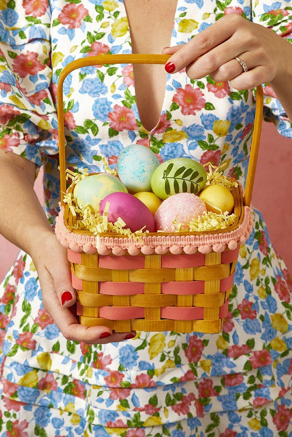 <p>Add color to a plain wicker basket by embellishing it with pompom trim and paint in a coordinating color. <br></p>