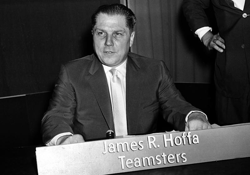 FILE - This July 26, 1959 file photo shows Teamsters Union president Jimmy Hoffa in Washington. Federal agents revived the hunt for the remains of Hoffa on Monday, June 17, 2013, digging around in a suburban Detroit field where a reputed Mafia captain says the Teamsters boss' body was buried. Authorities used excavation equipment to root around in the Oakland Township property, about 25 miles north of Detroit. (AP Photo/File)