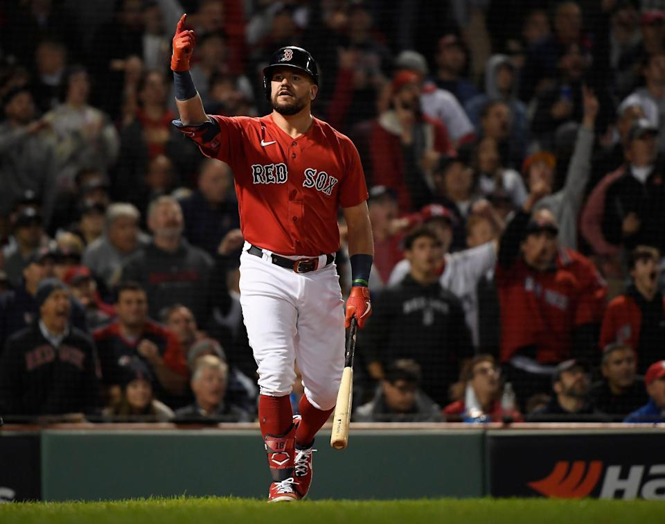 Red Sox designated hitter Kyle Schwarber reacts after hitting a solo home run in the third inning.