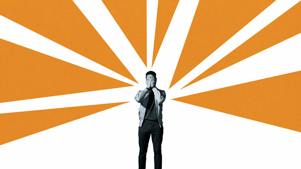 Graphic design image of stressed man inside orange and white beams of colour.