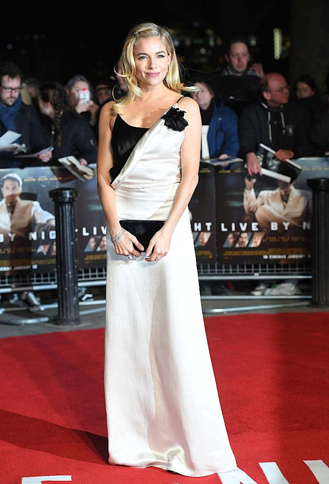 <p>Miller wore a black-and-white Lanvin evening dress with a slip silhouette to the European Premiere of her latest film, <i>Live by Night</i>, on Jan. 11 in London. (Photo: Getty Images) </p>
